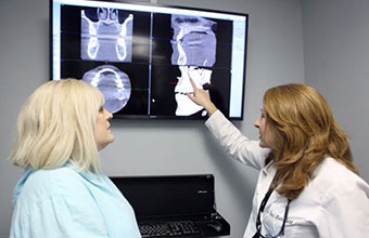 Doctor pointing to implants